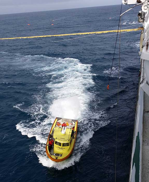 A workboat returns to the Polarcus Asima during the Flanagan 3D Seismic Survey.